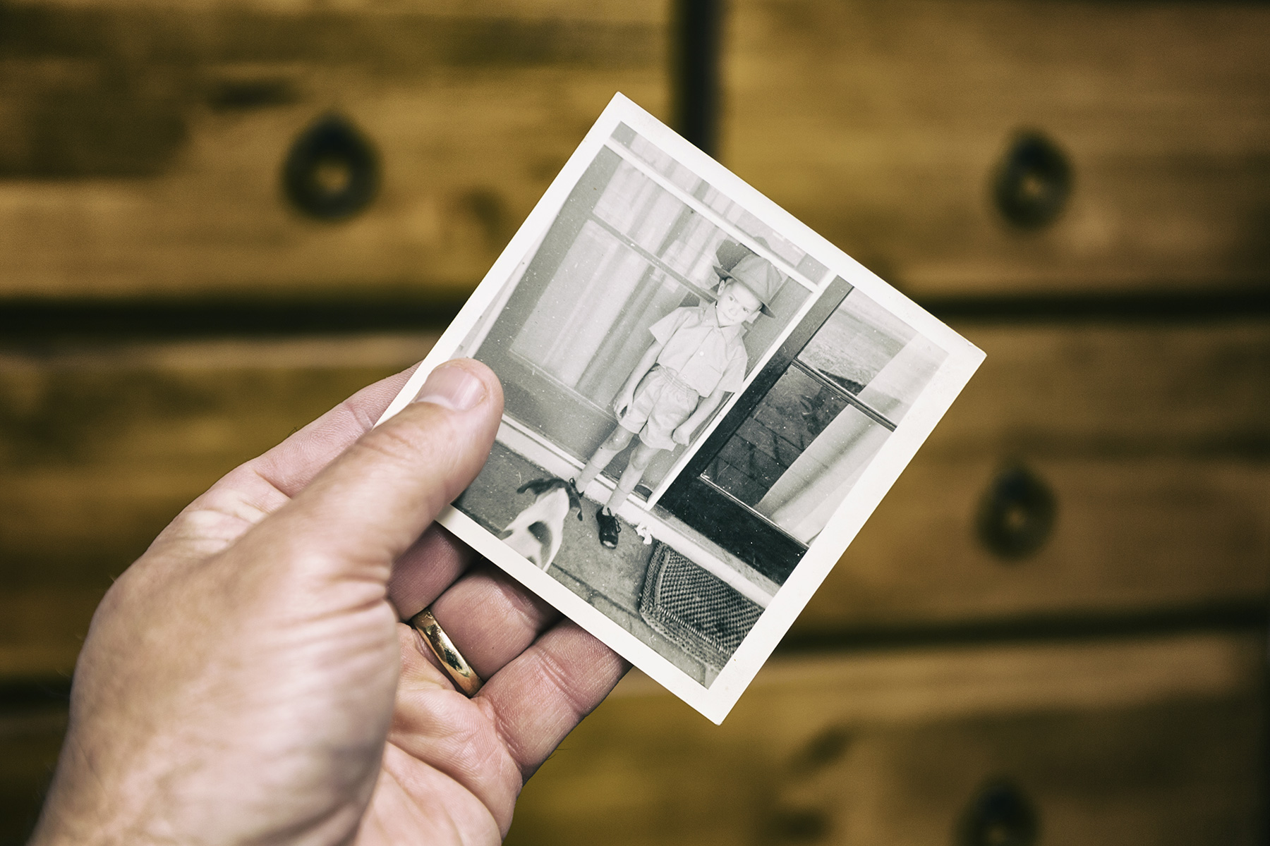 Elderly person looks at old photo