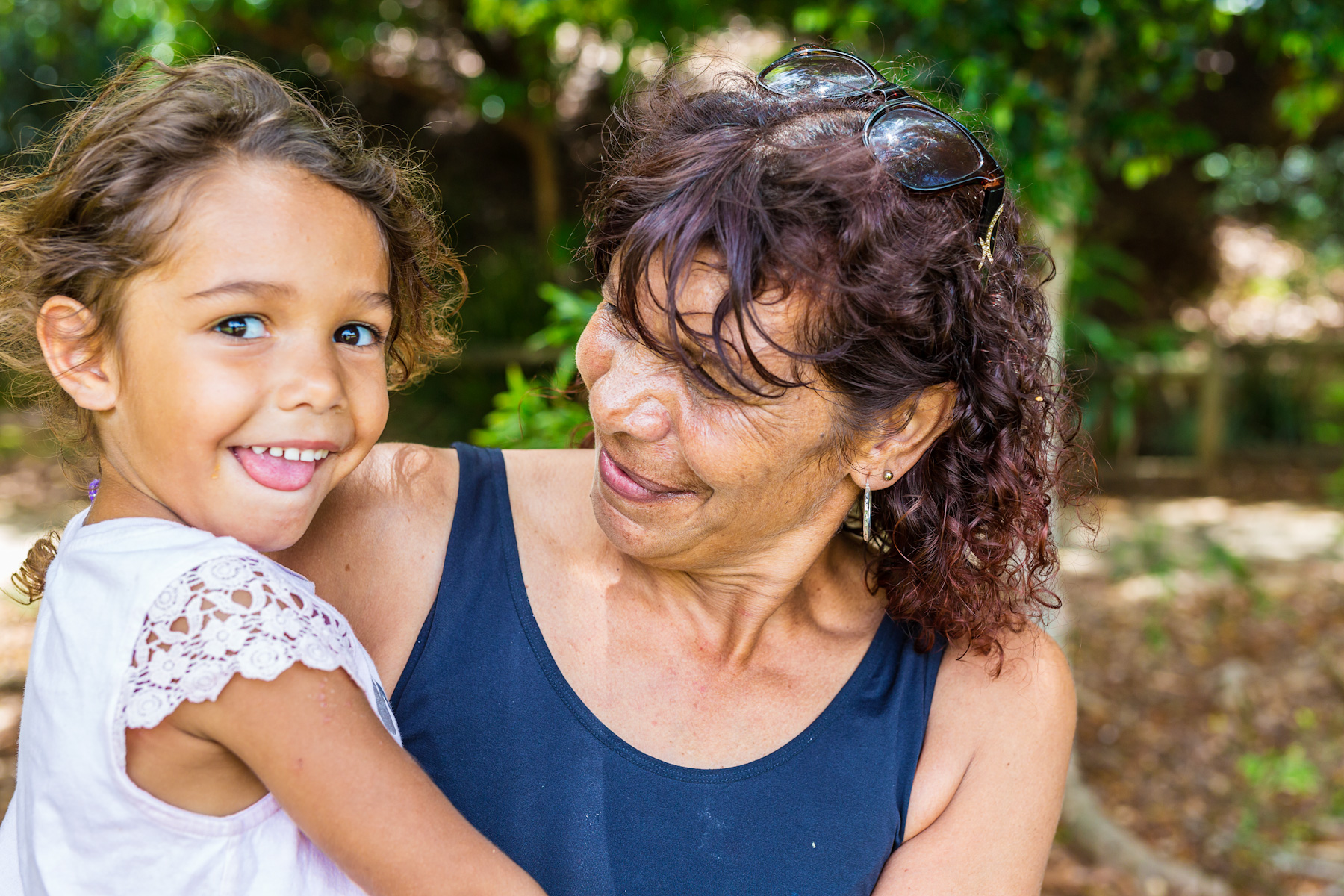 Aboriginal woman hugs grand daughter
