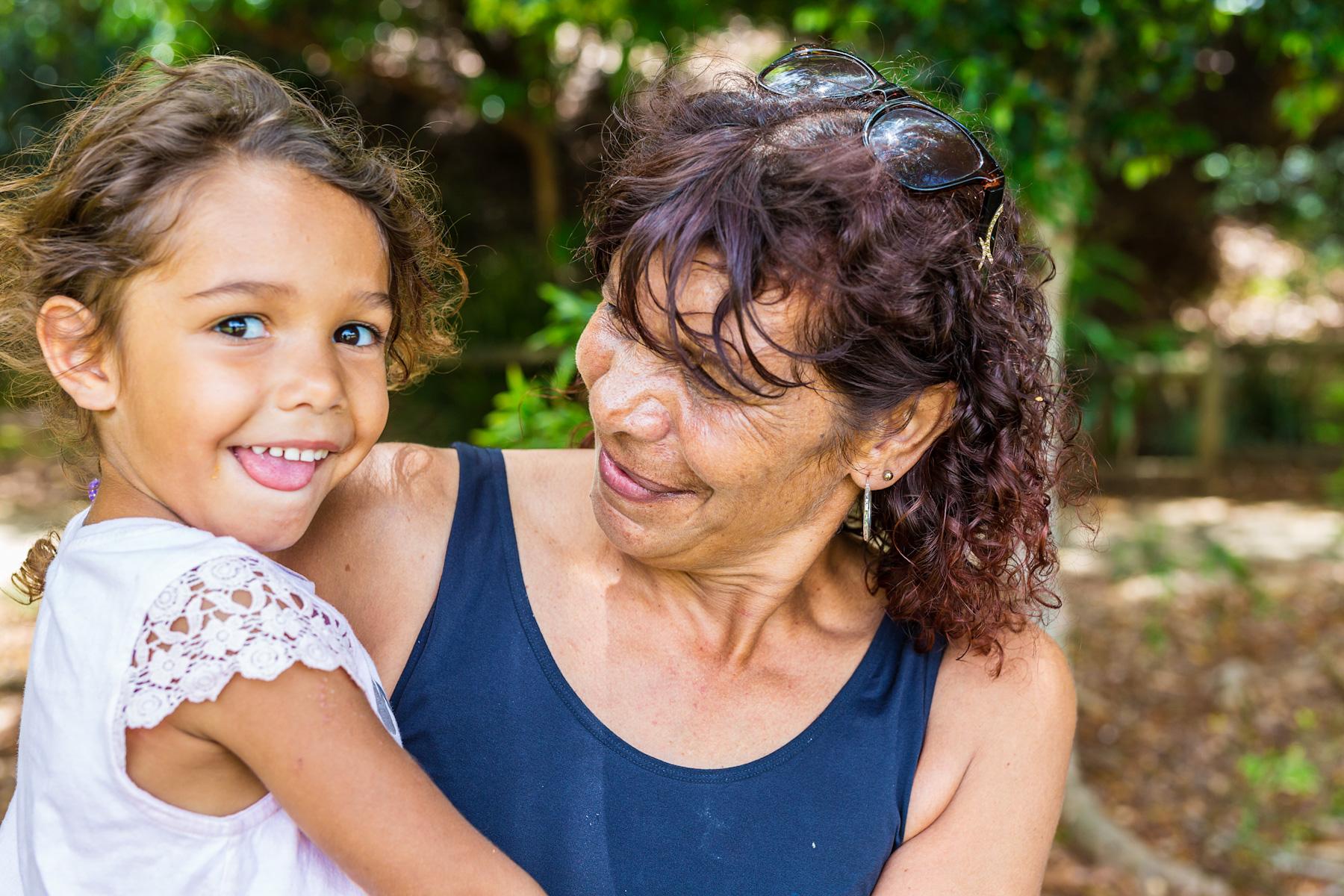 Aboriginal woman hugs grand daughter