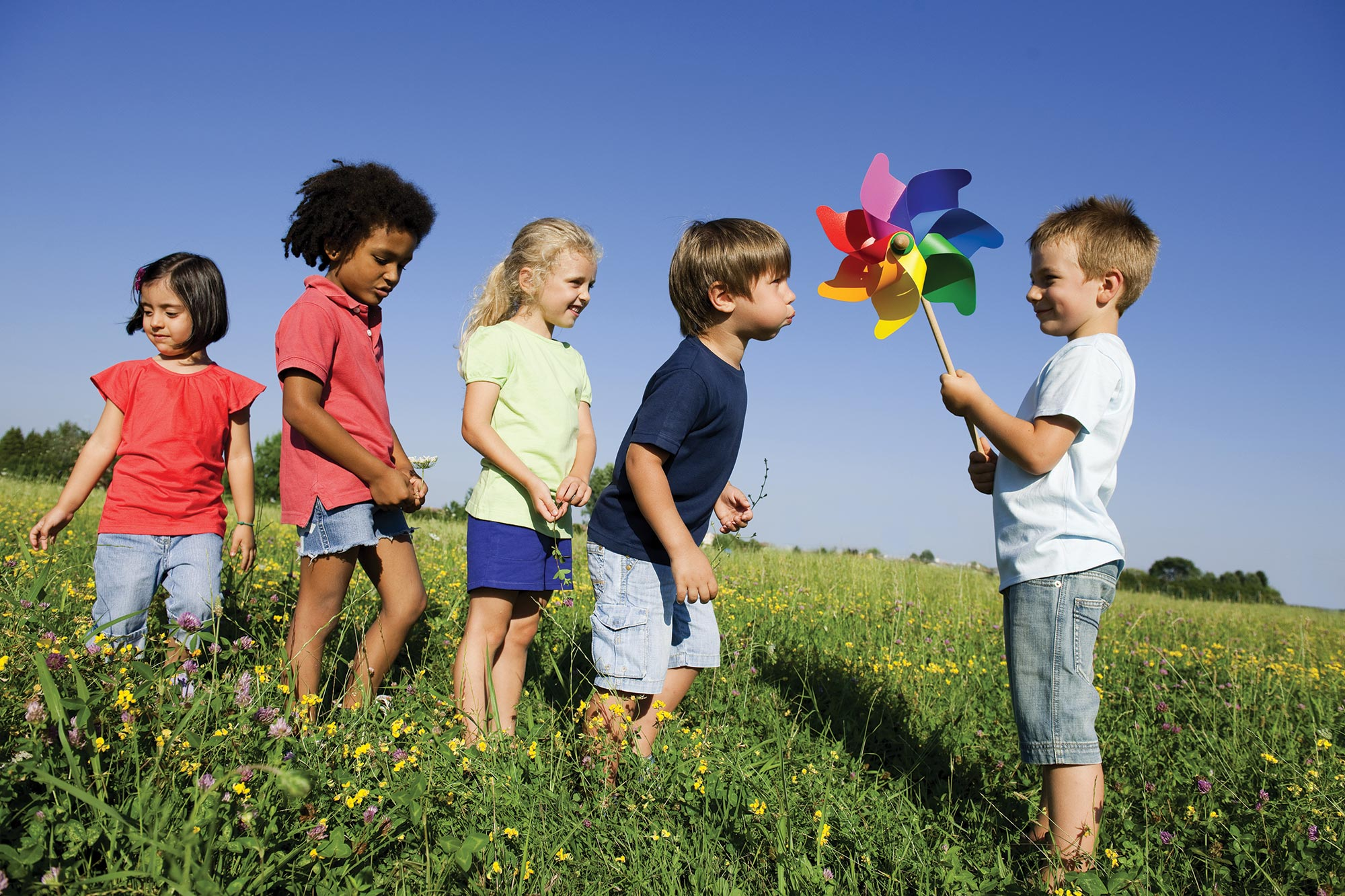Children play with a pinwheel